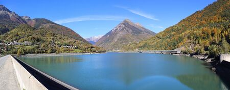 hydro power: Autumn landscape. French hydro power: Dam in the mountains