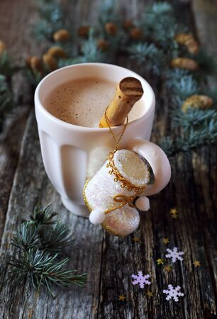 festive pine cones: New Years mood: mug of cappuccino, Christmas decorations and pine branches Stock Photo