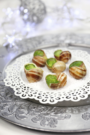 refinement: Traditional French dish: snails sauce Burgundy and Christmas decoration Stock Photo