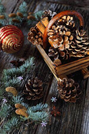 newyear: Christmas basket with cinnamon sticks and pine cones Stock Photo