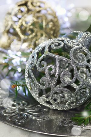 goldish: Fir branches and New Years decoration, two large balls and sparkling garland Stock Photo