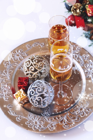 goldish: Christmas, festive mood: two glasses of champagne and New Years decoration Stock Photo
