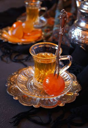 candied: Candied fruits and cup of green tea