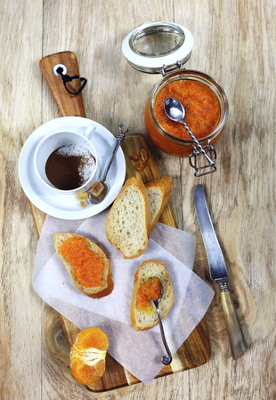 instant coffee: Tangerine jam, instant coffee and slices of baguette
