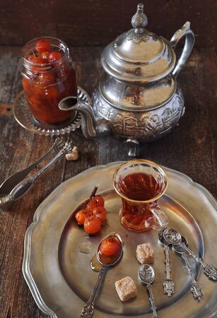 drinking of tea: Paradise apple jam and a cup of black tea Stock Photo