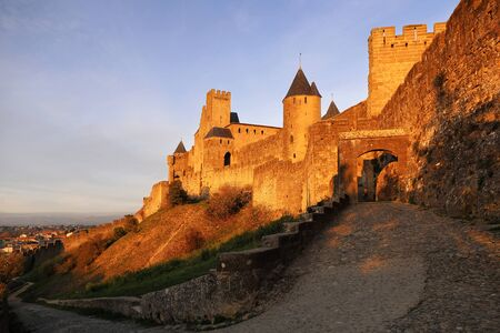 fastness: Medieval architecture of France: Carcassonne fortress at sunset