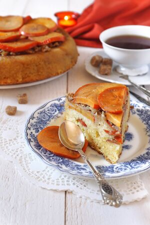 morsel: Persimmon cake and cup of tea Stock Photo
