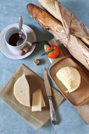lactic: Breakfast: fresh baguette, French cheese and butter Stock Photo