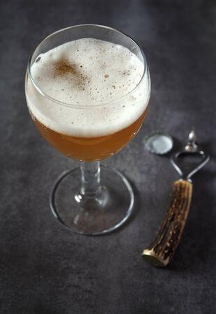 unfiltered: Unfiltered beer on dark surface