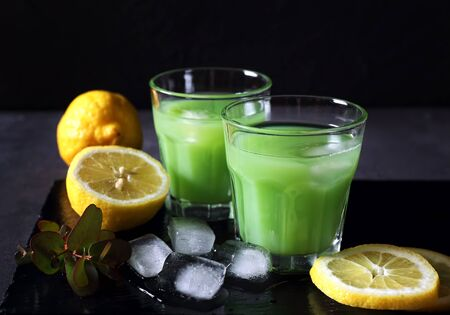 dietetical: Cactus juice,  lemons and ice on a dark background