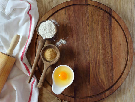 chopping board: Background: baking ingredients on wooden chopping board Stock Photo