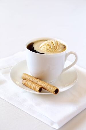 nicety: Cup of black coffee with ice cream and chocolate stick