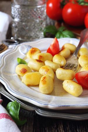 plato del buen comer: Italian cuisine: fried potato gnocchi with cheese and tomatoes