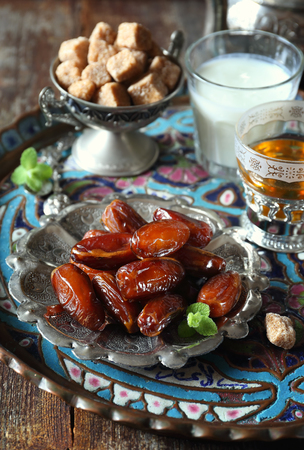 Oriental composition: ripe dates, green tea and fermented milk drink Stock Photo