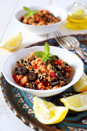 tabbouleh: Tabbouleh salad with tomato sauce, olives and red pepper