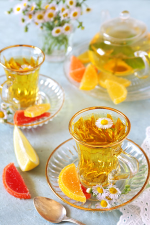 fruit jelly: Summer Tea Party: Herbal tea with fruit jelly Stock Photo