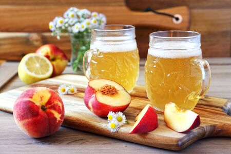 Light fruit craft beer, fruits and bouquet of wildflowers