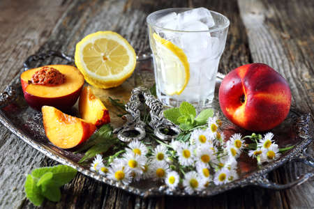 Summer refreshing drink making. Fruits, ice and mint