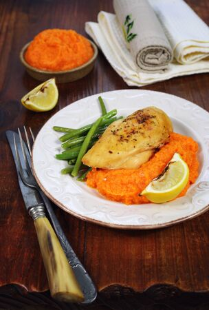 Bright dinner: roast chicken and mashed carrot