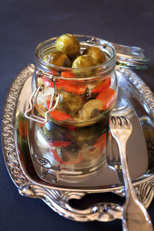 brussels sprouts: Pickled Brussels sprouts with vegetables in glass jar