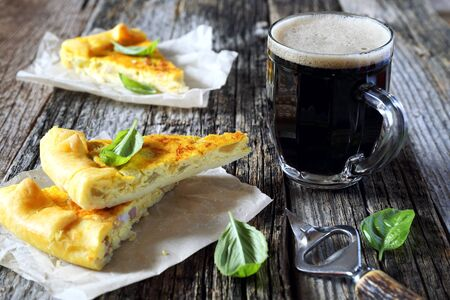 morsel: Appetizer: zucchini and lards quiche and mug of dark beer