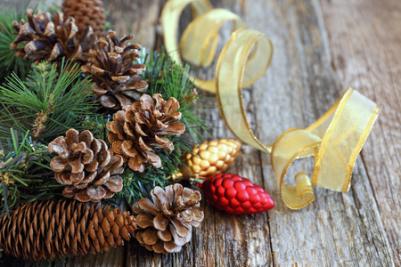 newyear: Background: pine cones and New-Year tree decorations on a wooden background