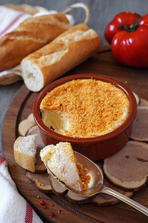 palatable: Traditional French dish: making of ?amembert fondue
