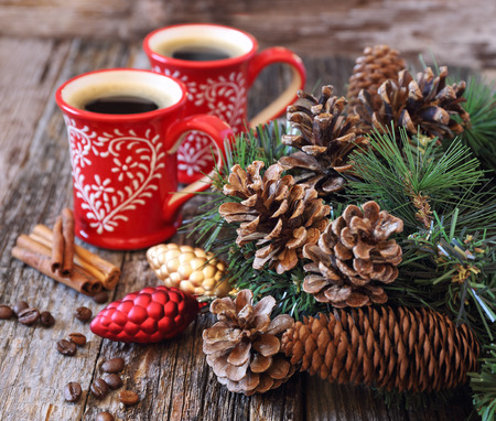 newyear: Two cup of coffee, pine cones and New-Year tree decorations on a wooden background Stock Photo