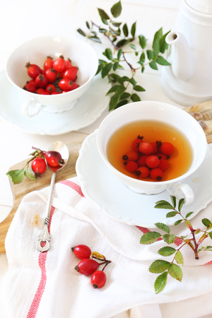 extract: Rose hip tea and berries, healthy extract Stock Photo