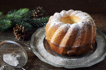 an icing: Christmas dessert: homemade Kouglof, icing sugar dressing Stock Photo