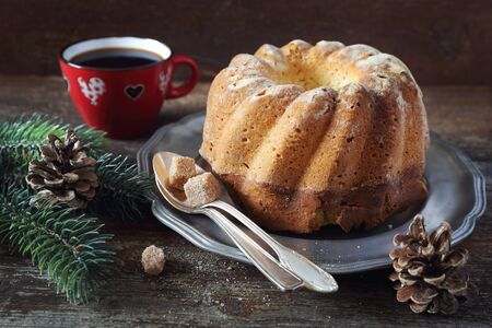 Christmas dessert: homemade Kouglof and cup of coffee