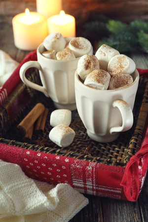 christmas marshmallows in two cups and burning candles toned image stock photo 66003323 - Christmas Marshmallows