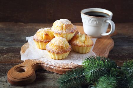 fir branch: New Year mood: lemon muffins, cup of coffee and fir branch Stock Photo