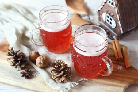 Two mugs of winter craft beer in New Year decorations Stock Photo