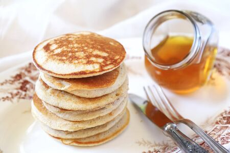 Pancake with honey on vintage plate Stock Photo