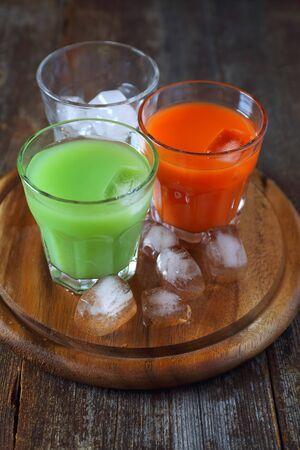 Assortment of juice: carrot and cactus Stock Photo