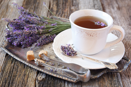 Summer mood: ?romatic lavender tea and fresh lavender on vintage tray, rustic style on old wooden background