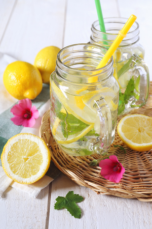 Two glasses of cool refreshing drink: pure water, lemon and mint Stock Photo