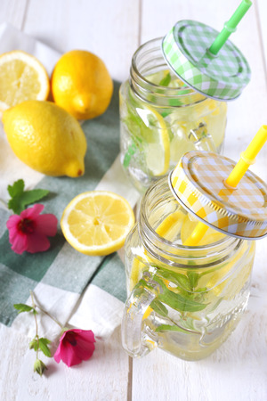 Two glasses of cool refreshing detox drink: pure water, lemon and mint Stock Photo