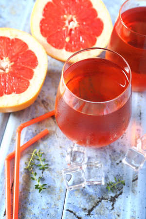 Cold summer drink: two glass of grapefruit rose wine and fruits
