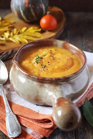 Vegetable pumpkin cream soup. Rustic style Stock Photo