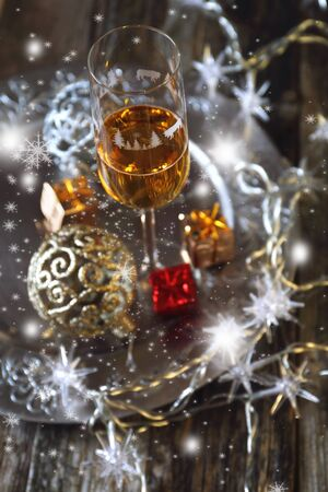 Christmas, festive mood: glass of champagne and New Year's decoration