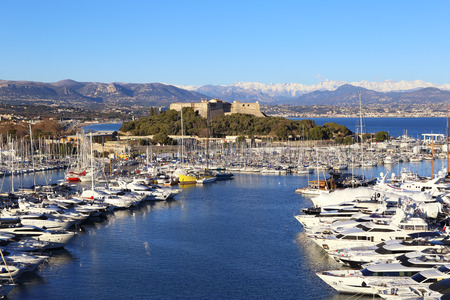 French Riviera: winter evening in the resort of Antibes. View of port, yachts and fortress