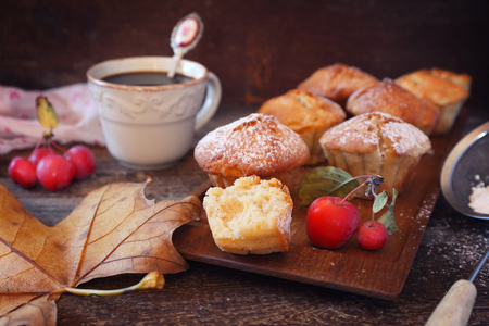 Autumn coffee break with apple muffins. Rustic stile, toned image Archivio Fotografico