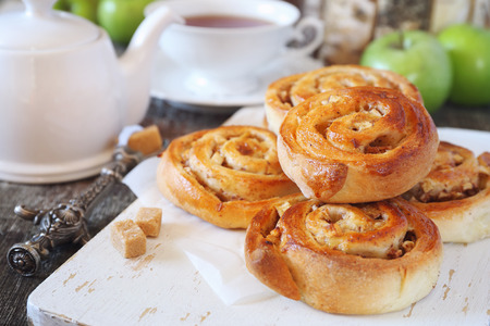 Homemade pastry. Apple and cinnamon sweet buns, green apples and cup of tea Stock Photo