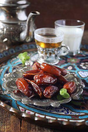 Oriental Ramadan composition: ripe dates, green tea and fermented milk drink Foto de archivo
