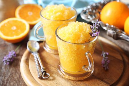 Orange granita, frozen summer dessert and  blooming lavender dressing, selective focus