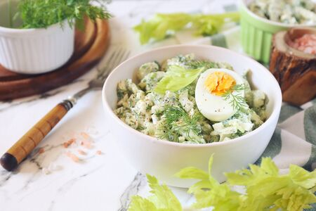 Vitamin light vegetable salad with dill, celery, eggs and Greek yogurt 写真素材