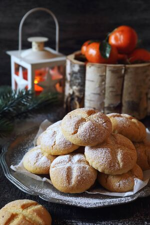 Winter festive baking. Homemade tangerine cookies, powdered sugar dressing. Rustic style