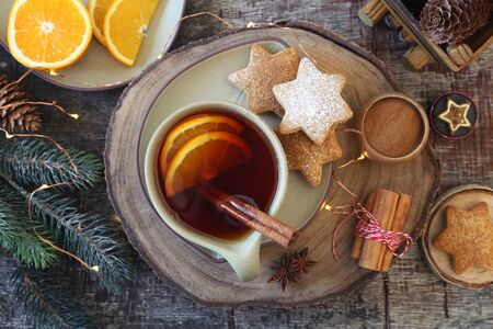 Christmas cinnamon cookies (spice-cake),  cup of spicy tea and New Years decoration. Rustic style. Top view